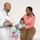 African-American mother and baby girl with male pediatrician.