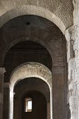 Arched walkway in Rome, Italy.