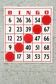 Red bingo card with winning chips.