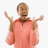 Portrait of African American woman looking surprised against white background.