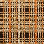 Close-up of woven vintage fabric with brown and gold crossbar pattern.