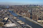 Aerial view of Harlem River and bridges with the Bronx and Manhattan buildings in New York City.
