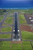Aerial view of Maui, Hawaii airport with Pacific ocean.