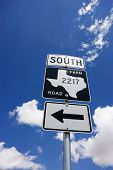 Highway sign denoting south Texas farm road with arrow.