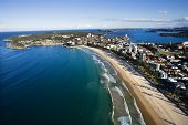 Aerial view of beachfront buildings and ocean in Sydney, Australia.