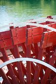 Close-up of red paddlewheel of riverboat in Sacramento, California, USA.