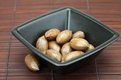 pic of pecan tree  - pecans in a bowl on a bamboo mat - JPG