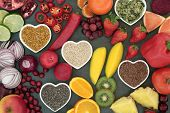 Paleo diet health and super food of fruit, vegetables, nuts and seeds in heart shaped bowls on slate poster