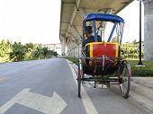 Trishaw Under A Bridge