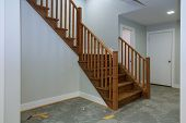 Hallway Interior With Hardwood Floor. View Of Wooden Stairs. Door Beside The Stairs poster