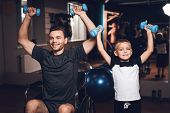 Father And Son In The Gym. Father And Son Spend Time Together And Lead A Healthy Lifestyle. Man And  poster