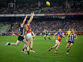 MELBOURNE - AUGUST 20 : Collingwood's  Tyson Goldsack (L) spoils Patrick Karnezis of Brisbane in Collingwood's win over Brisbane - August 20, 2011 in Melbourne, Australia.
