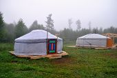 Two Buryat Yurt In The Background Of The Misty Morning