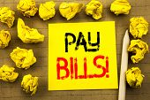 Pay Bills. Business Concept For Finance Paying Online Written On Sticky Note Paper On The Vintage Ba poster