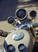 picture of speedo  - Motorcycle dashboard closeup image and reflections on metal surfaces - JPG