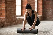 Attractive Happy Fit Young Woman Unfolding Black Yoga Or Fitness Mat Before Working Out In Loft Yoga poster
