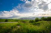 Majestic Landscape Of Mountains And Meadow. Cycling Mountain Road. Misty Mountain Road In High Mount poster