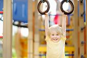 Little Boy Having Fun On Outdoor Playground. Summer Active Sport Leisure For Kids. Kindergarten Or S poster
