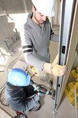 Men installing wall panel