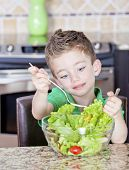 Young Boy Making Salad