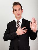 picture of take responsibility  - Success Man With Arm On Chest Taking Oath - JPG