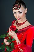 Sensual Woman With Rose On Dark Background. Ballroom Dancer In Red Dress With Flower. Fashion, Beaut poster