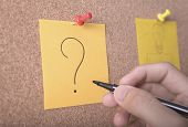 Hand Writeing Question Mark On Sticky Note Or Post Is On Cork Bulletin Billboard. poster