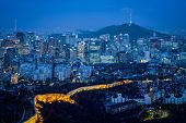 Seoul downtown cityscape illuminated with lights and Namsan Seoul Tower in the evening view from Inw poster