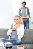 Couple eating breakfast together at home