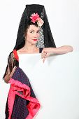 image of senorita  - Woman wearing traditional Spanish dancer outfit - JPG