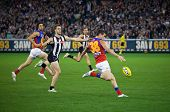 MELBOURNE - AUGUST 20 : Brisbane's  Tom Rockliffe (R) in action during their loss to Collingwood - A