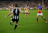 MELBOURNE - AUGUST 20 :  Collingwood's  Alan Didak kicks the ball during their win over Brisbane - A