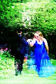 Abstract Prom Couple Walking Outdoors