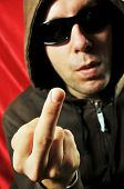 image of gangsta  - Gangsta man wearing sunglasses gesturing f - JPG