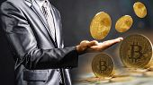 Businessman Holding Bitcoin On Black Background,businessman Hand Holding Golden Bitcoin, Cryptocurre poster