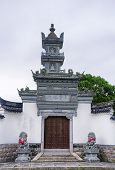 A Wall Surrounding And Entrance To The Duo Bao, Multi Treasure, Pagoda In The Puji Temple Scenic Are poster