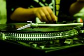 Dj Playing Music From Vinyl Record