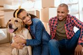 Happy African American Family With Labrador Dog Moving To New Apartment poster