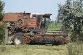 Old Rusty Combine Harvester. Combine Harvesters Agricultural Machinery. The Machine For Harvesting G poster