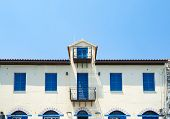 Symmetrical Order Of Blue Windows And Door On Exterior Wall In Simple Architectural Layout. poster