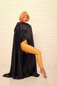 Funky Style Beauty. Sensual Woman In Fashion Style On White Brickwall. Fashion Model Wearing Orange  poster