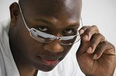 African man touching sunglasses