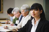 Asian businesswoman at meeting