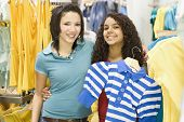 Multi-ethnic teenage girls in clothing store