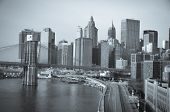 New York City, Brooklyn Bridge in sunrise with Lower Manhattan background - Split toned