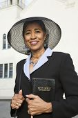 foto of piety  - Senior African American woman in front of church - JPG
