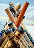 stock photo of didgeridoo  - A display of didgeridoos the world