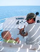 Little Boy And Captain On The Boat