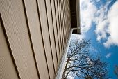 pic of downspouts  - Downspout and siding on an urban house - JPG