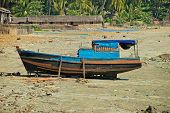 Burmese boat on the shore